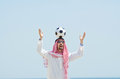Arab with footbal at seaside Stock Photo