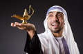 Arab with lamp isolated on the white Royalty Free Stock Photos