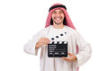 Arab man with movie clapper on white Royalty Free Stock Photography