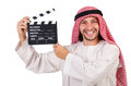 Arab man with movie clapper on white Royalty Free Stock Photos