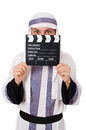 Arab man with movie clapper on white Stock Images