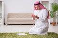 The arab man praying at home