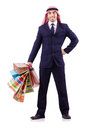 Arab man with shopping gifts on white Stock Photography