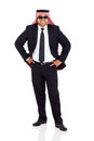 Arab man suit cheerful in black posing on white background Royalty Free Stock Photo