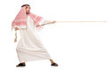 Arab man tug war concept Royalty Free Stock Photo