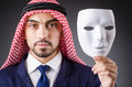 Arab with masks in dark studio Royalty Free Stock Photography