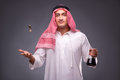The arab with oil on gray background Royalty Free Stock Photo