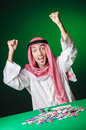Arab playing in casino Stock Image