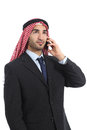 Arab saudi businessman talking on the mobile phone isolated a white background Stock Image