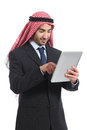 Arab saudi emirates businessman working with a tablet reader isolated on white background Stock Images