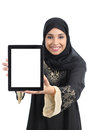 Arab saudi emirates happy woman showing an app in a tablet screen isolated on white background Royalty Free Stock Image