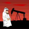Arab Sheikh with an oil pump behind him Royalty Free Stock Photo