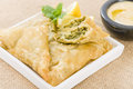 Arab snacks sarma grape vine leaves stuffed with rice borek spinach and cheese stuffed pastry and fatayer meat pie Royalty Free Stock Images