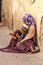 Arab woman with a child begging in the street is an editorial vertical image Stock Images