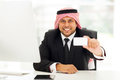 Arabian business card happy businessman handing his Stock Images
