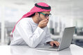 Arabian business man looking shocked at his computer Stock Photography