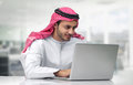 Arabian business man using notebook in the office Stock Photo