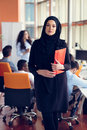 Arabian business woman with hijab holding a folder Royalty Free Stock Photo