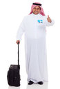 Arabian businessman travel cheerful with luggage giving thumb up Royalty Free Stock Image
