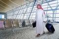 Arabian businessperson walks in airport Royalty Free Stock Photo