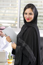 Arabian Businesswoman with her boss on Background Royalty Free Stock Photo