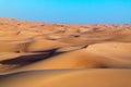 Arabian desert dune background on blue sky desert near the city of dubai desert landscape dunes stretching into horisont Stock Image
