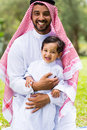 Arabian father son happy and outdoors Stock Photo