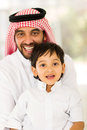Arabian father son home portrait of and sitting at Royalty Free Stock Image