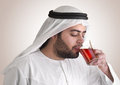 Arabian guy drinking tea / aroma tempting beverage Royalty Free Stock Photography