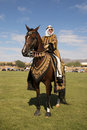 Arabian horse with costumed rider beautiful female during a presentation at horses and horsepower championship polo at westworld Royalty Free Stock Photo