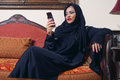 Arabian lady wearing hijab chatting Stock Photos