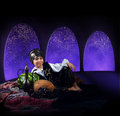 Arabian magic night liitle boy in reach orient dress in palace Stock Photography