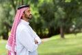 Arabian man arms crossed cute with looking away Royalty Free Stock Image