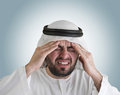 Arabian man having a headache Royalty Free Stock Image