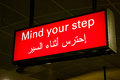 Arabian mind your step sign Royalty Free Stock Images