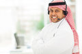 Arabian it support friendly male worker with headphone Stock Photo