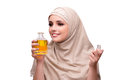 The arabian woman with bottle of perfume isolated on white Royalty Free Stock Photo