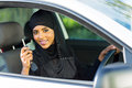 Arabian woman car key happy holding inside new vehicle Royalty Free Stock Image