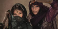 Arabian woman traveling in desert. Sandstorm effect not noise Royalty Free Stock Photo