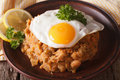 Arabic Breakfast: ful medames with a fried egg close-up. horizon Royalty Free Stock Photo