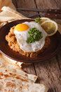 Arabic Breakfast: ful medames with a fried egg close-up. Vertica Royalty Free Stock Photo