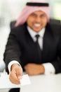 Arabic businessman card giving his business Stock Photography