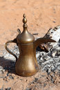 Arabic coffee pot at a fireplace Stock Photos