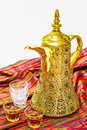 Arabic coffee pot or kahwa with glasses and cloth as background Royalty Free Stock Image
