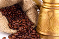 Arabic copper turks and  scattered coffee grains Stock Image