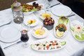 Arabic food of dates hommos cheese labneh and fattoush served during ramadan Royalty Free Stock Images