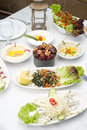 Arabic food of dates hommos cheese labneh and fattoush served during ramadan Royalty Free Stock Image