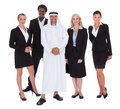 Arabic man standing with businesspeople over white background Royalty Free Stock Image