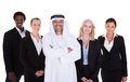 Arabic man standing with businesspeople Royalty Free Stock Photo