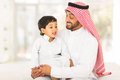 Arabic man talking son lovely men to his Stock Photography